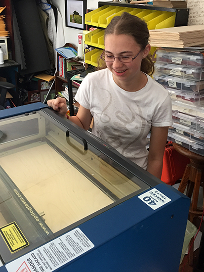 Aly in the laser engraving sweatshop!